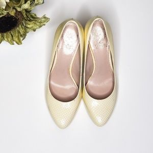 Vince Camuto yellow textured pumps